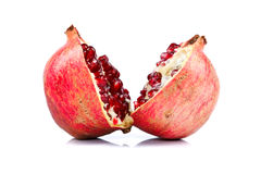Grenadine cut in halves. Pomegranate cut in halves over white background Royalty Free Stock Photo