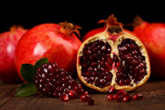 Grenadine fruits and seeds on wooden table Royalty Free Stock Photography