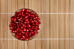 Grenadine seeds in glass bowl, upper view Stock Image