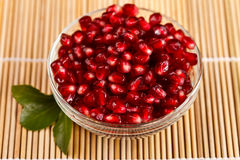 Grenadine seeds with little green leaf Stock Photography