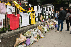 The Grenfell Tower Block Fire Disaster. Floral tributes and messages for the victims of the Grenfell Tower fire disaster, London, UK, which left hundreds stock image