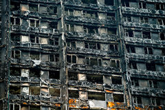 The Grenfell Tower Block Fire Disaster. Low angle view of the burnt remains of the Grenfell Tower block in London, UK, which left hundreds homeless and many dead Royalty Free Stock Photo