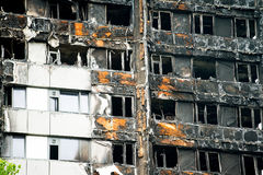 The Grenfell Tower Block Fire Disaster. Low angle view of the burnt remains of the Grenfell Tower block in London, UK, which left hundreds homeless and many dead Royalty Free Stock Image