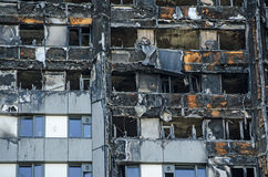 Grenfell Tower close up. Close up view of the exterior of the Grenfell Tower block of flats in which at least 80 people lost their lives in a fire.  Remains of Royalty Free Stock Photos