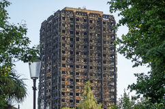Grenfell Tower remains. Charred remains of the Grenfell Tower block of council flats in which at least 80 people are feared to have died in a fire, Kensington Royalty Free Stock Image