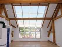 Grenier Windows et lumières de ciel Images stock