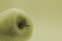 Grenn Apple. Green Apple detail in a green background Stock Photo