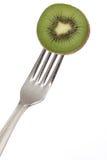 Grenn kiwi on a fork. Isolated Stock Photo