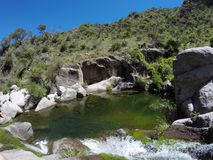 Grenn Laguna to swim in San Luis, Argentina. Natural pool with beautiful green colors which is called Laguna de las uvas, in San Luis, Argentina stock photography