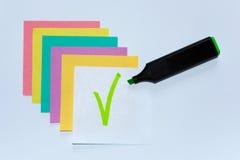 Grenn mark on white paper V. Grenn mark on white paper. Colored Leaflets for Recording Royalty Free Stock Photo
