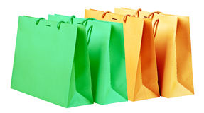 Grenn and orange shopping bags. Royalty Free Stock Photos