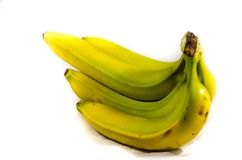 Grenn and yellow banana`s on there side. Fruits of four different banana cultivars Stock Images