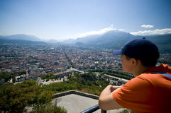 Grenoble. A teenager overlooking Grenoble, France Royalty Free Stock Image