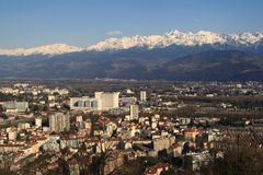 Grenoble. View on the red roofs, university and Alpes at Grenoble in France Royalty Free Stock Images