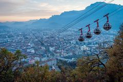 Grenoble and cable cars at dusk Royalty Free Stock Images