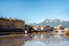 Grenoble city in France. Morning cityscape view with mountains, river and bridge in Grenoble city on the south-east of France Royalty Free Stock Photos