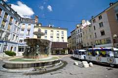 Grenoble city square. Grenoble, France. City square with little train taking tourists for a city sightseeing Royalty Free Stock Photography