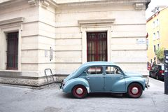 Grenoble, France. An old automobile in a corner of Grenoble, France surrounded by mountains Royalty Free Stock Photos
