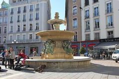 Grenoble old city fountain on Place Grenette. France Royalty Free Stock Photography