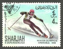 Grenoble Winter Olympics. Sharjah - stamp 1968, Multicolor Edition, Winter sports, Offset Printing, Grenoble Winter Olympics 1968, Skiing Stock Photo