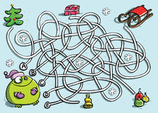 Grenouille drôle dans le jeu de labyrinthe de l'hiver Image stock