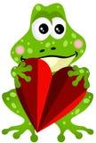 Grenouille tenant un coeur Image libre de droits