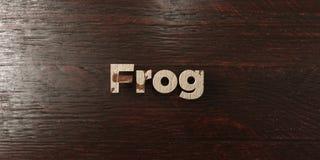Grenouille - titre en bois sale sur l'érable - image courante gratuite de redevance rendue par 3D Photos libres de droits