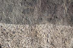 Grens van twee oppervlakten van natuursteen als achtergrond Royalty-vrije Stock Fotografie