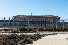 Grensomheining in San Diego met Arena in Tijuana stock foto's