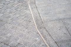 Grenze von Pflastersteinen in der alten Stadt Lizenzfreie Stockfotos