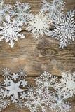 Grenze von Weihnachtsschneeflocken Lizenzfreies Stockfoto