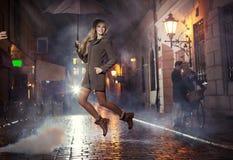 Grerat portrait of jumping joyful girl Stock Photography