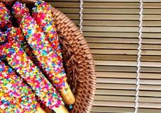 Gressins en chocolat sur le fond Photos libres de droits