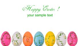 Gretting Easter card. With color eggs and white copy space Stock Photos