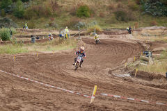 GREVENBROICH, GERMANY - OCTOBER 01, 2016: Unidentified motocross riders fight for qualification Stock Photo
