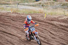 GREVENBROICH, GERMANY - OCTOBER 01, 2016: Unidentified motocross riders fight for qualification Stock Photos
