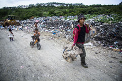 Grew up in Landfills. Children followed their mother who worked as scavengers, must be willing to spend their childhood at a landfill Royalty Free Stock Photo