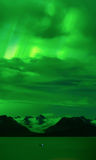 Grewingk Glacier under Green Aurora glow Royalty Free Stock Photos