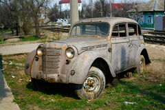 Grey abandoned old Moskvich car on the street of Volgograd Royalty Free Stock Images