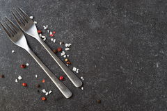 Grey abstract background with forks, salt. Place for text. Stock Images