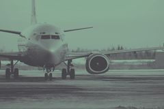 Grey Airplane on Runway Stock Images