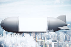 Grey airship with billboard city Stock Photos