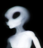 Grey alien illuminated Royalty Free Stock Photography