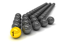 Grey arrow of the balls with the gold leader in front. Stock Photos