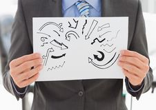 Grey arrow doodles on card held by business man mid section Stock Photography