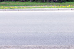 Grey asphalt, border, green grass Stock Photo