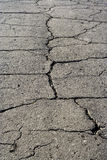 Grey asphalt road surface texture with fissure. Old asphalt road surface texture with fissure Stock Images