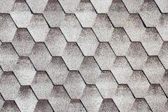Grey asphalt roofing shingles. Gray hexagon roof tiles pattern Royalty Free Stock Photo