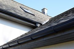 Grey asphalt shingles roof construction royalty free stock photography