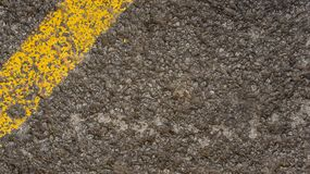 Grey asphalt texture with yellow line in the corner royalty free stock photo